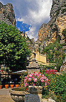 France. Provence. Moustiers-Ste. Marie.  Alpes de Haute Provence.  There is a large gilded star suspended on an iron chain between the two hillsides in the background, reputed to have been installed by the Chevallier de Blacas on his return from the Crusades.