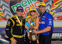 Sept. 1, 2014; Clermont, IN, USA; NHRA top fuel dragster driver Richie Crampton (left) with teammate Morgan Lucas and wife Katie Lucas and son Hunter Lucas celebrate after winning the US Nationals at Lucas Oil Raceway. Mandatory Credit: Mark J. Rebilas-USA TODAY Sports