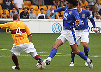Nicky Law and Marouane Fellaini challenge in the Motherwell v Everton friendly match at Fir Park, Motherwell on 21.7.12 for Steven Hammell's Testimonial.