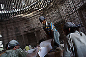 Migrant labourers are seen working inside the Asia's Biggest Dome, the Kashi Ram Smarak (monument) built by Uttar Pradesh chief minister, Mayawati in Lucknow, India. The dalit chief minister, Mayawati is channeling huge state funds into making statutes of herself with her mentor, Kashi Ram all across Lucknow.