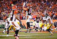 Tyler Eifert #85 of the Cincinnati Bengals catches a pass in front of Ryan Shazier #50 of the Pittsburgh Steelers during the Wild Card playoff game at Paul Brown Stadium on January 9, 2016 in Cincinnati, Ohio. (Photo by Jared Wickerham/DKPittsburghSports)