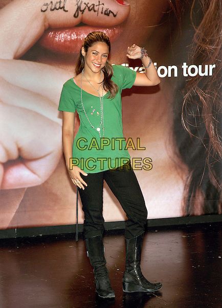 SHAKIRA.Announces Oral Fixation Tour at the Supper Club, New York City, NY, USA, 28 April 2006..full length green top ripped holes pink bra underwear silver necklaces hand waving black trousers boots wedges wedge.Ref: ADM/JL.www.capitalpictures.com.sales@capitalpictures.com.©Jackson Lee/AdMedia/Capital Pictures.