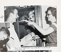 BNPS.co.uk (01202 558833)<br /> Pic: HeritageAuctions/BNPS<br /> <br /> Oswald in his high school yearbook being hypnotised by classmate Janet Bolin.<br /> <br /> The last paycheck issued to President Kennedy's killer Lee Harvey Oswald has emerged for sale for £15,000. ($20,000)<br /> <br /> Also going under the hammer is Oswald's 1957 high school yearbook for his final year at Arlington Heights High School in Fort Worth, Texas.<br /> <br /> One bizarre photo inside the yearbook, which is expected to fetch £1,200, shows him being hypnotised by a female pupil.<br /> <br /> Oswald infamously shot John F Kennedy while his motorcade passed through Dallas, Texas on November 22, 1963.<br /> <br /> The former marine was himself assassinated by Jack Ruby at the local police headquarters two days later.