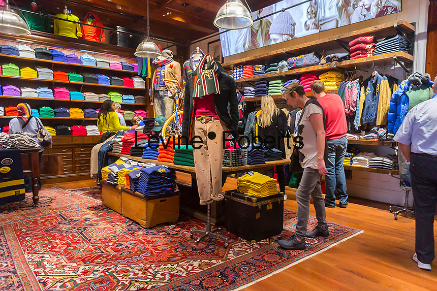 Shoppers in the brand new Polo Ralph Lauren store of Fifth Avenue in New York on Friday, September 12, 2014. Besides being a flagship store on a premiere shopping street Lauren is following the lead of numerous other retailers and has a coffee shop inside the store. The cafe sells Ralph's Coffee with the custom blend of beans personally chosen by coffee aficionado Lauren.  (© Richard B. Levine)