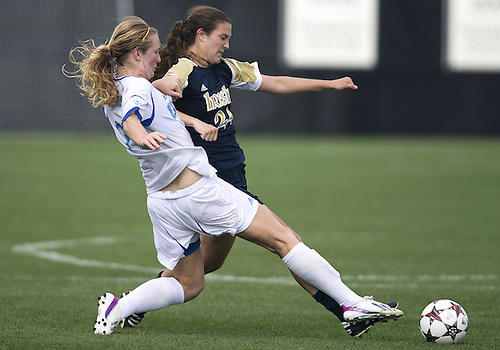 September 01, 2013:  UCLA midfielder Samantha Mewis (#22) and Notre Dame defender Katie Naughton (#24) battle for the ball during NCAA Soccer match between the Notre Dame Fighting Irish and the UCLA Bruins at Alumni Stadium in South Bend, Indiana.  UCLA defeated Notre Dame 1-0.