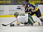 16 February 2008: University of Vermont Catamounts' forward Viktor Stalberg, a Sophomore from Gothenburg, Sweden, is checked by Merrimack College Warriors' forward Kurtis Astle, a Freshman from Port Coquitlam, B.C., at Gutterson Fieldhouse in Burlington, Vermont. The Catamounts defeated the Warriors 2-1 for their second win of the 2-game weekend series...Mandatory Photo Credit: Ed Wolfstein Photo
