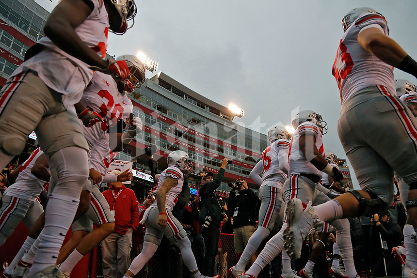 The Buckeyes enter Memorial Stadium for warmups before their night game against Nebraska Cornhuskers in Lincoln, Neb on October 14, 2017.  [Kyle Robertson/Dispatch]