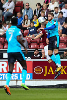 Fleetwood Town's Wes Burns competing in the air<br /> <br /> Photographer Andrew Kearns/CameraSport<br /> <br /> The EFL Sky Bet League One - Northampton Town v Fleetwood Town - Saturday August 12th 2017 - Sixfields Stadium - Northampton<br /> <br /> World Copyright &copy; 2017 CameraSport. All rights reserved. 43 Linden Ave. Countesthorpe. Leicester. England. LE8 5PG - Tel: +44 (0) 116 277 4147 - admin@camerasport.com - www.camerasport.com