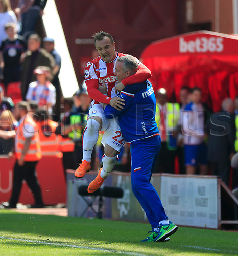 5th May 2018, bet365 Stadium, Stoke-on-Trent, England; EPL Premier League football, Stoke City  versus Crystal Palace; Xherdan Shaqiri of Stoke City celebrates scoring the opening goal of the game in the 43rd minute with his manager Paul Lambert