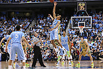 14 March 2015: North Carolina's Brice Johnson wins the opening tipoff. The Notre Dame Fighting Irish played the University of North Carolina Tar Heels in an NCAA Division I Men's basketball game at the Greensboro Coliseum in Greensboro, North Carolina in the ACC Men's Basketball Tournament quarterfinal game. Notre Dame won the game 90-82.