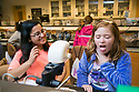 Nina MacLeod, 10, gets grossed out when viewing fruit fly larvae through a microscope Sweta Kafle, Duke first-year, looks on during FEMMES (Females Excelling More in Math, Engineering, and Science) Capstone event. The event was a free, annual one-day outreach program introducing young women from Durham (4th through 6th grade) to math, science and engineering. <br /> The goal of FEMMES (Females Excelling More in Math, Engineering and Science) is to give girls hands-on experience in fields where women are often greatly under-represented. By using female volunteers and faculty members, we hope to demonstrate that women can and do excel in these fields. Each faculty volunteer directs a hands-on activity that shows something interesting and fun about their area of expertise. Student volunteers lead groups to the activities and act as mentors for the day to our program&rsquo;s participants.