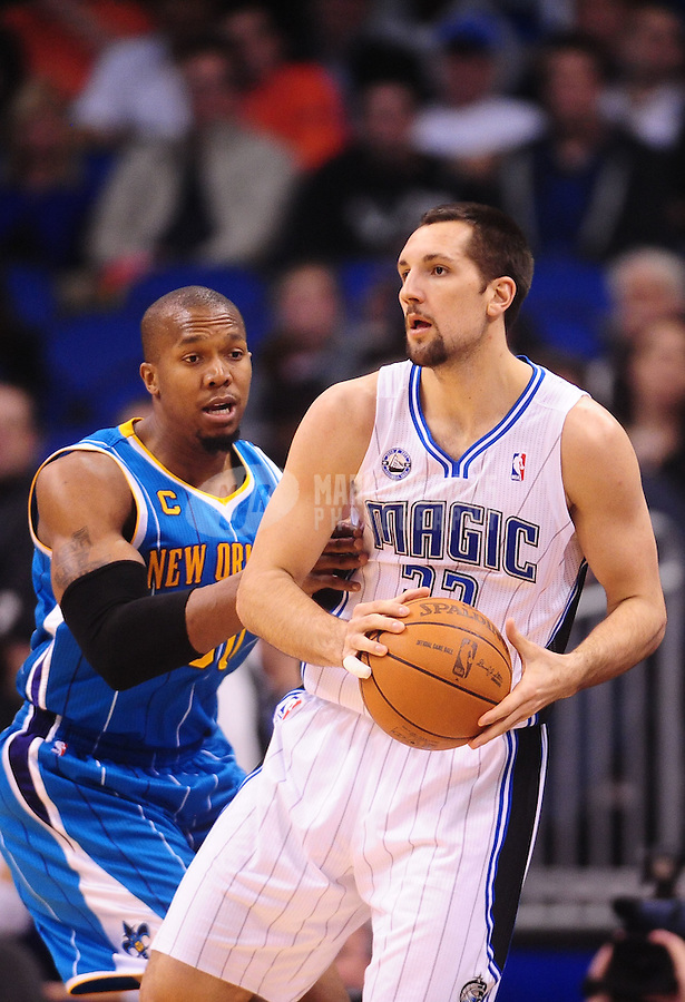 Feb. 11, 2011; Orlando, FL, USA; Orlando Magic forward (33) Ryan Anderson against New Orleans Hornets forward (30) David West at the Amway Center. The Hornets defeated the Magic 99-93. Mandatory Credit: Mark J. Rebilas-USA TODAY Sports