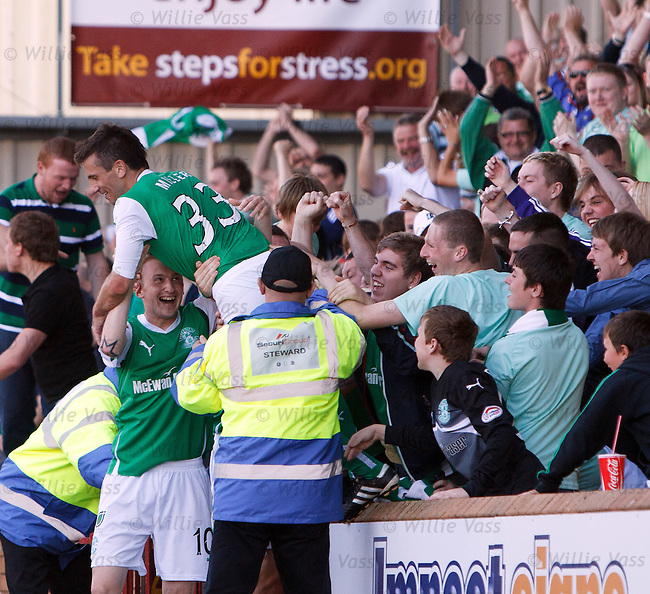 Liam Miller jumps into the travelling Hibs support to celebrate scoring gol no 3 for Hibs