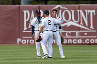 Kane County Cougars outfielders Tra Holmes (3) and Alek Thomas (2) celebrate after shortstop Blaze Alexander's (5) diving catch during a Midwest League game against the Cedar Rapids Kernels at Northwestern Medicine Field on April 28, 2019 in Geneva, Illinois. Kane County defeated Cedar Rapids 3-2 in game one of a doubleheader. (Zachary Lucy/Four Seam Images)