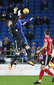 31st October 2017, Cardiff City Stadium, Cardiff, Wales; EFL Championship football, Cardiff City versus Ipswich Town; Bartosz Bialkowski of Ipswich Town and Sean Morrison (C) of Cardiff City collide midair challenging for the ball resulting in a freekick being awarded to Ipswich Town
