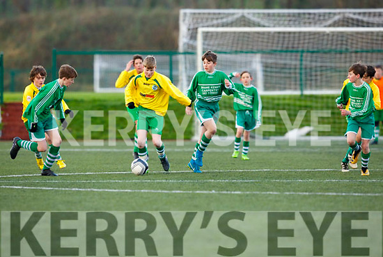 Peadar Kelleher Killarney Celtic takes on the Shelbourne defence  in the FAI cup in Celtic Park on Saturday