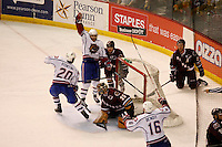 Jun 7, 2007; Hamilton, ON, CAN; Hamilton Bulldogs center (26) Maxim Lapierre celebrates his goal on Hershey Bears goalie (35) Frederic Cassivi during the second period in game five of the Calder Cup finals at Copps Coliseum in Hamilton, ON. Mandatory Credit: Ron Scheffler