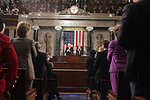 Wide shot from the center isle of the United States House of Representatives chamber as United States President George W. Bush delivers his State of the Union Address to a Joint Session of Congress in the Capitol in Washington, D.C. on February 2, 2005.  United States Vice President Dick Cheney, left, and the Speaker of the United States House of Representatives J. Dennis Hastert (Republican from the 14th District of Illinois), right, applaud from behind.<br /> Credit: Luke Frazza / Pool via CNP