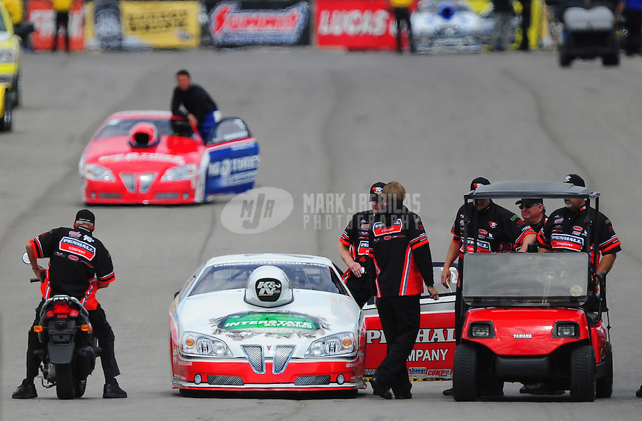 Apr. 1, 2012; Las Vegas, NV, USA: NHRA pro stock driver Mike Edwards is surrounded by crew members following a run during the Summitracing.com Nationals at The Strip in Las Vegas. Mandatory Credit: Mark J. Rebilas-