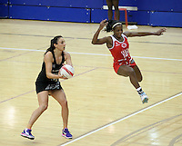 20.1.2014 New Zealand's Joline Henry competes for ball with England's Sasha Corbin during their netball test match in London, England. Mandatory Photo Credit (Pic: David Klein). ©Michael Bradley Photography.
