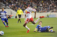 Macoumba Kandji (10) of the New York Red Bulls goes down after being fouled by Zach Loyd (19) of FC Dallas in the penalty box. The New York Red Bulls defeated FC Dallas 2-1 during a Major League Soccer (MLS) match at Red Bull Arena in Harrison, NJ, on April 17, 2010.