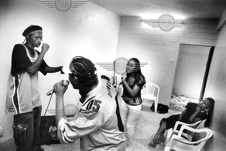 © Dieter Telemans / Panos Pictures..Dakar, SENEGAL..Rappers Xuman (left) of the ?Pee Froiss? group, ?Abbas? and Maryam of the ?ALIF? group, in preparation for a concert in Lille, France. ?Pee Froiss? is one of the few Senegalese rap groups that enjoy an international reputation. Xuman, in contrast to most of his colleagues, believes that they can learn a lot from Europeans. ?In our community all that glitters is gold: external appearance has become fundamental. We boast about our teranga, our hospitality, but it really isn?t much but a show of wealth. Yes, we spend fortunes, not for education or health services, but for naming ceremonies for our children. We want our own festivities to be more magnificent and count more guests than our neighbours. I sometimes die with shame.? Photo:  Dieter Telemans / Panos Pictures/Felix Features