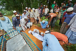 Rohingya refugees bury a woman in the cemetery of the sprawling Kutupalong Refugee Camp near Cox's Bazar, Bangladesh. More than 600,000 Rohingya have fled government-sanctioned violence in Myanmar for safety in Bangladesh.