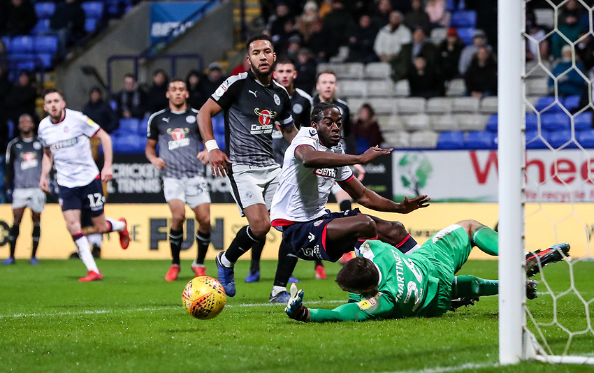 Bolton Wanderers' Clayton Donaldson competing with Reading's goalkeeper Emiliano Martinez  <br /> <br /> Photographer Andrew Kearns/CameraSport<br /> <br /> The EFL Sky Bet Championship - Bolton Wanderers v Reading - Tuesday 29th January 2019 - University of Bolton Stadium - Bolton<br /> <br /> World Copyright © 2019 CameraSport. All rights reserved. 43 Linden Ave. Countesthorpe. Leicester. England. LE8 5PG - Tel: +44 (0) 116 277 4147 - admin@camerasport.com - www.camerasport.com