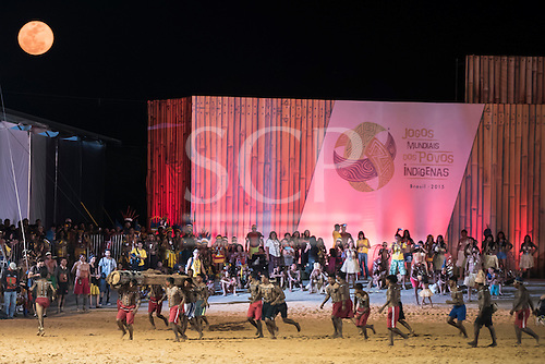 Indigenous peoples of many ethnic groups watch a demonstration of the log race by Xerente warriors under a full moon at the International Indigenous Games, in the city of Palmas, Tocantins State, Brazil. Photo © Sue Cunningham, pictures@scphotographic.com 27th October 2015