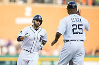 J.D. Martinez (28) of the Detroit Tigers is greeted by third base coach Dave Clark (25) as he rounds the bases after hitting a home run against the Chicago White Sox at Comerica Park on June 2, 2017 in Detroit, Michigan.  The Tigers defeated the White Sox 15-5.  (Brian Westerholt/Four Seam Images)