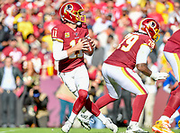 Landover, MD - November 4, 2018: Washington Redskins quarterback Alex Smith (11) drops back to pass during game between the Atlanta Falcons and the Washington Redskins at FedEx Field in Landover, MD. The Falcons defeated the Redskins 38-13. (Photo by Phillip Peters/Media Images International)