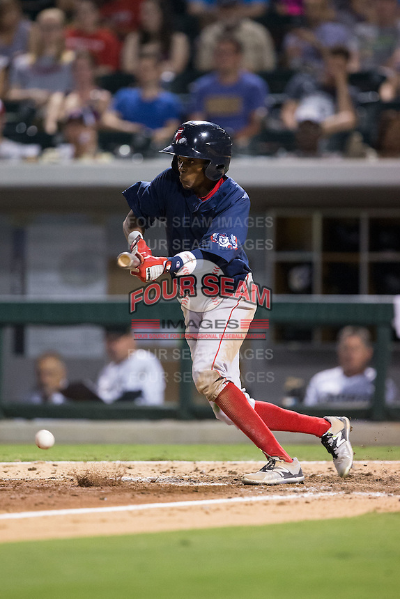 Jose Vinicio (2) of the Pawtucket Red Sox runs up to bunt against the Charlotte Knights at BB&T BallPark on July 6, 2016 in Charlotte, North Carolina.  The Knights defeated the Red Sox 8-6.  (Brian Westerholt/Four Seam Images)