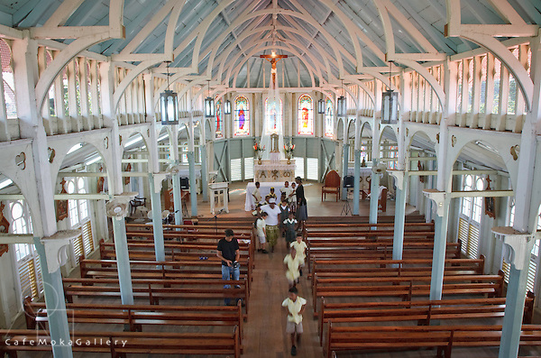 Schoolchildren moving down the aisle of Our Lady of Montserrat Church, Tortuga Central Trinidad