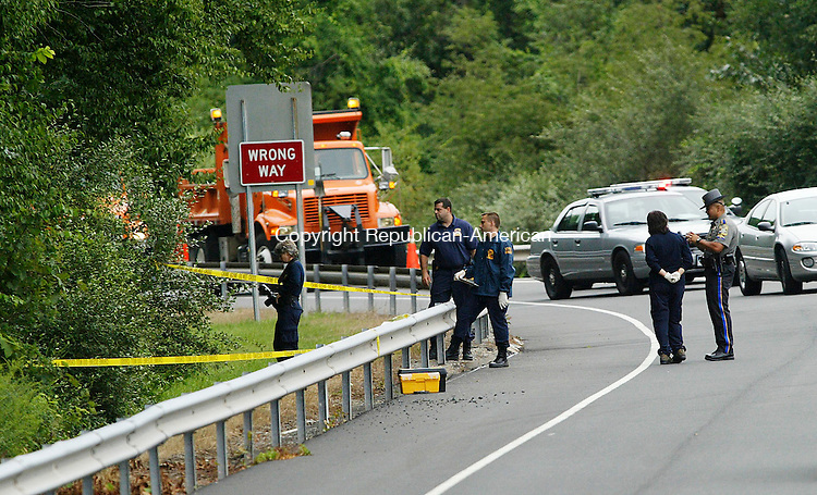 THOMASTON, CT 8/22/07- 082207BZ01- Connecticut State Police examine an area next to the exit 40 off-ramp on Rte. 8 South after a body was discovered Wednesday.<br /> Jamison C. Bazinet Republican-American