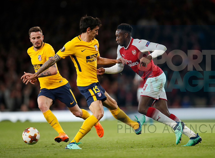 Arsenal's Danny Welbeck goes down under the challenge of Stefan Savic but no foul is given as Atletico's go up the other end and score during the Europa League Semi Final 1st Leg, match at the Emirates Stadium, London. Picture date: 26th April 2018. Picture credit should read: David Klein/Sportimage