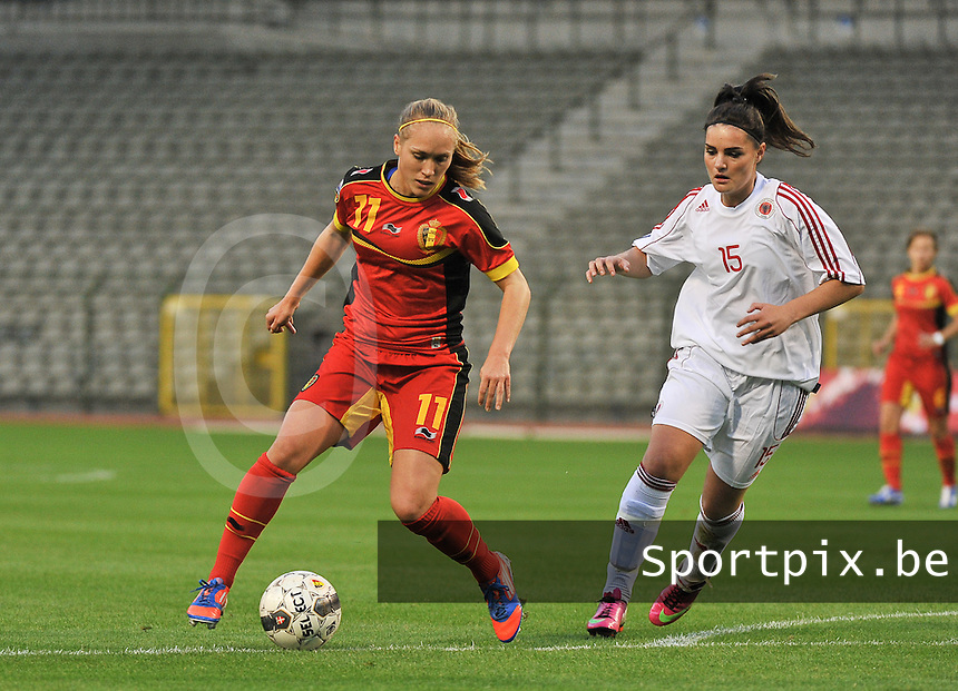 20130921 - BRUSSELS , BELGIUM : Belgian Janice Cayman (11) pictured with Albanian Luta Dielona (15)  during the female soccer match between Belgium and Albania , on the first matchday in group 5 of the UEFA qualifying round to the FIFA Women World Cup in Canada 2015 at the Koning Boudewijn Stadion , Brussels . Saturday 21th September 2013. PHOTO DAVID CATRY