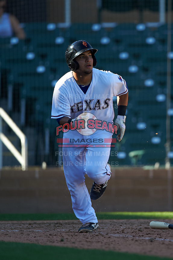 Surprise Saguaros catcher Jose Trevino (45) runs to first during an Arizona Fall League game against the Glendale Desert Dogs on October 23, 2015 at Salt River Fields at Talking Stick in Scottsdale, Arizona.  Glendale defeated Surprise 9-6.  (Mike Janes/Four Seam Images)
