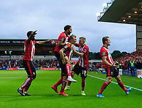 Lincoln City's Harry Anderson, third in from left, celebrates scoring the opening goal with team-mates, from left, John Akinde, Bruno Andrade, Joe Morrell and Harry Toffolo<br /> <br /> Photographer Chris Vaughan/CameraSport<br /> <br /> The Carabao Cup Second Round - Lincoln City v Everton - Wednesday 28th August 2019 - Sincil Bank - Lincoln<br />  <br /> World Copyright © 2019 CameraSport. All rights reserved. 43 Linden Ave. Countesthorpe. Leicester. England. LE8 5PG - Tel: +44 (0) 116 277 4147 - admin@camerasport.com - www.camerasport.com