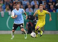 FUSSBALL   DFB POKAL 2. RUNDE   SAISON 2013/2014 TSV 1860 Muenchen - Borussia Dortmund         24.09.2013 Benjamin Lauth (li, 1860 Muenchen) gegen Marco Reus (Borussia Dortmund)