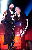 The Prodigy - vocalists Maxim Reality and  Keith Flint -  performing live at the Brixton Academy, London UK - 03 Dec 2004.  Photo credit: George Chin/IconicPix