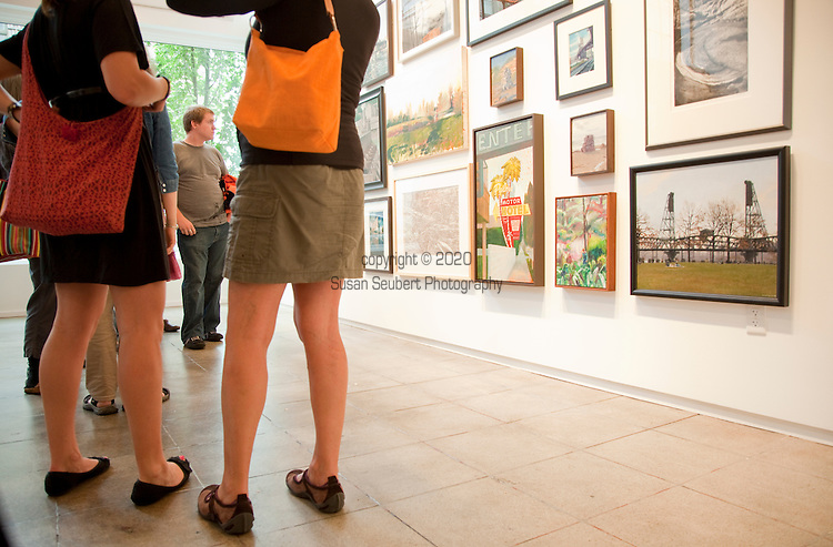 On the first Thursday of every month, art galleries in Portland hold receptions and stay open later in the evening to launch their new shows.  The galleries are primarily located in the Pearl District, but include the Everett Station Lofts and independent artists set up in the streets around the Pacific Northwest College of Art.  Pictured here is the Froelick Gallery in the newly developed DeSoto Building.