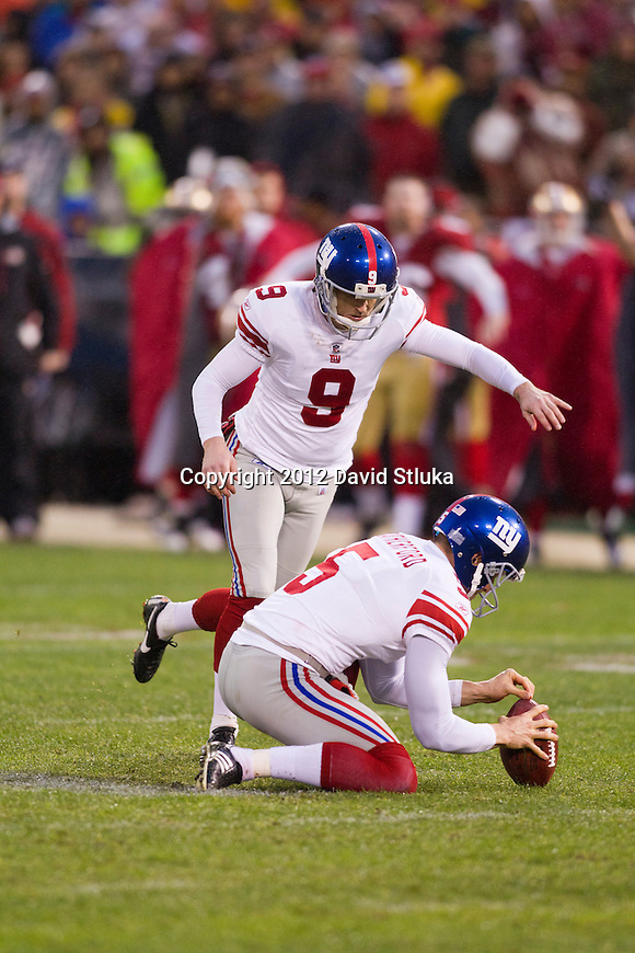 New York Giants holder/punter Steve Weatherford (5) holds the ball for kicker Lawrence Tynes (9) during an NFC Championship NFL football game against the San Francisco 49ers on January 22, 2012 in San Francisco, California. The Giants won 20-17 in overtime. (AP Photo/David Stluka)