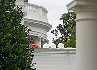 Construction helmets on the roof of the White House West Wing looking towards the South Portico in Washington, DC as it is undergoing renovations while United States President Donald J. Trump is vacationing in Bedminster, New Jersey on Friday, August 11, 2017.<br /> Credit: Ron Sachs / CNP /MediaPunch