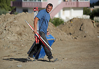 Pictured: A forensic archaeologist works at the second site in Kos, Greece. Thursday 13 October 2016<br />