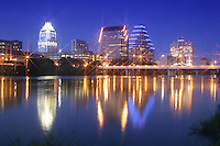 Austin, Texas downtown night city skyline with lights reflecting on the glass-like still waters of Townlake in Austin, Texas, USA - Stock Image
