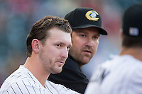Chris Curley (left) and Brad Penny of the Charlotte Knights in the dugout during the game against the Norfolk Tides at BB&T BallPark on July 17, 2015 in Charlotte, North Carolina.  The Knights defeated the Tides 5-4.  (Brian Westerholt/Four Seam Images)