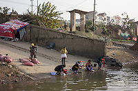 Residents wash laundries in Poyang county at Poyang Lake, Jiangxi Province, December 2014. Poyang Lake, located in the north of Jiangxi Province, is the largest freshwater lake in China. It fluctuates dramatically between wet and dry seasons, from 3,500 square kilometres down to about 200 square kilometres. The lake provides a habitat for half a million migratory birds.