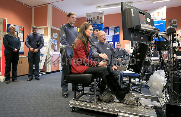 14 February 2017 - Princess Kate Duchess of Cambridge flies a flight simulator during a visit to the RAF Air Cadets at RAF Wittering in Stamford, Lincolnshire.  The Duchess of Cambridge is Royal Patron and Honorary Air Commandant of the Air Cadet Organisation. Photo Credit: ALPR/AdMedia