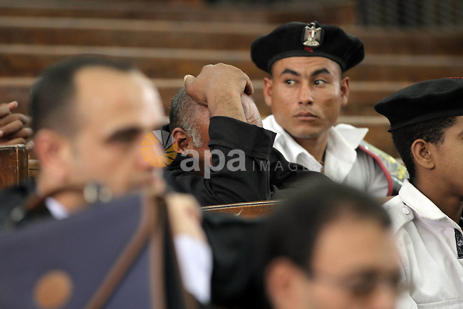 Egyptians attend the trial of Muslim Brotherhood members in the capital Cairo on June 17, 2014. The court postponed  to July 23 the verdict in the trial of Muslim Brotherhood Supreme Guide Mohamed Badie and 50 others in the case of the Rabaa operating room. Photo by Mohammed Bendari