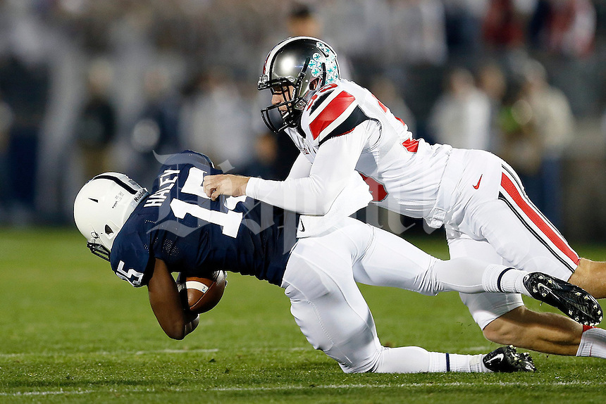 Ohio State Buckeyes place kicker Kyle Clinton (39) tackles Penn State Nittany Lions cornerback Grant Haley (15) after a kickoff during the first quarter of the NCAA Division I football game at Beaver Stadium in University Park, PA on October 25, 2014. (Columbus Dispatch photo by Jonathan Quilter)